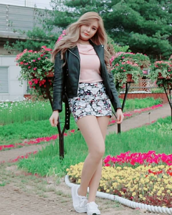 Leather Jacket + Baby Pink Top + Flower Skirt + White Sneakers