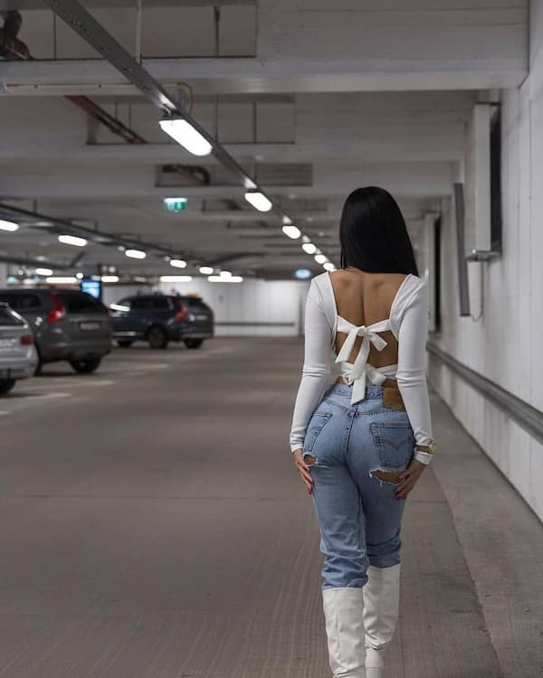Open-Back White Long Sleeve + Ripped Jeans + Knee High Boots