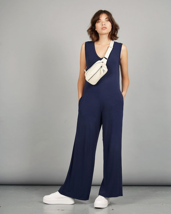 Atlanta Jumpsuit with Pocket and White Trainers + Bag