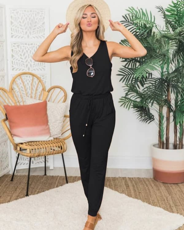 Black Sleeveless Jumpsuit with Sandals and Hat