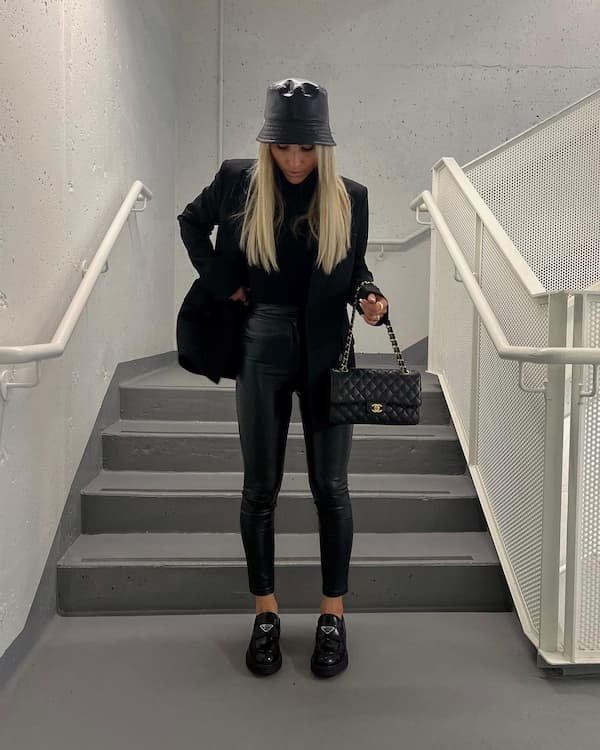 Black Top with Blazer + Leather Pants and Loafers + Bucket Hat + Chic Bag
