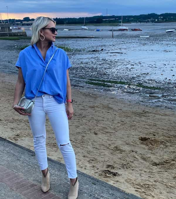 Blue Short Sleeve Shirt with Ripped White Jeans and Boots + Sling Bag + Sunglasses