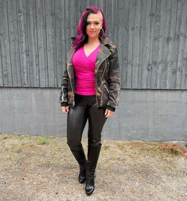 Pink V-necked Shirt with Leather Leggings and Knee High Boots
