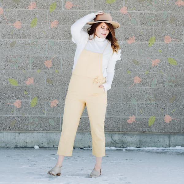 Sleeveless Jumpsuit with White Turtle Neck Long Sleeve Shirt and Loafers