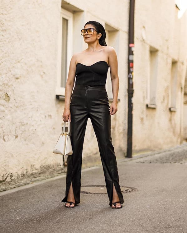 Strapless Black Top with Open-Legged Leather Pants and Heels + Chic Bag
