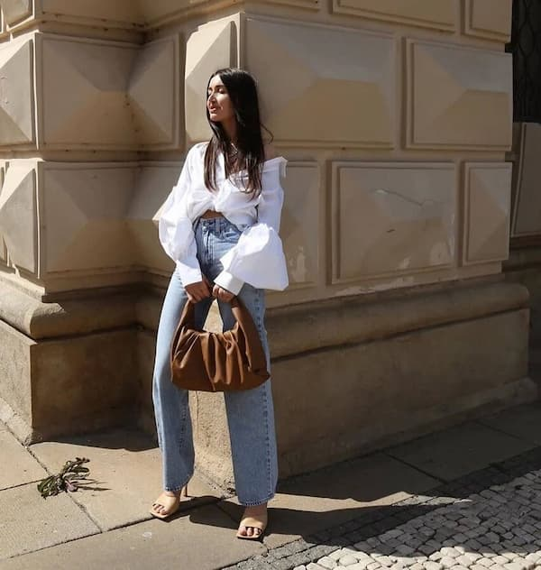 White Fluffy Blouse with Light Blue Jeans and Heels + Handbag