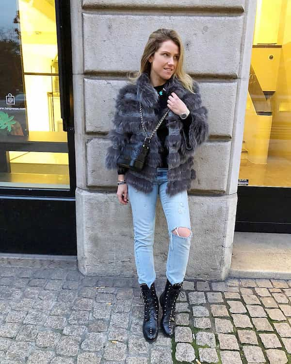 Women's Fur Jacket with Ripped Light Blue Jeans and Boots